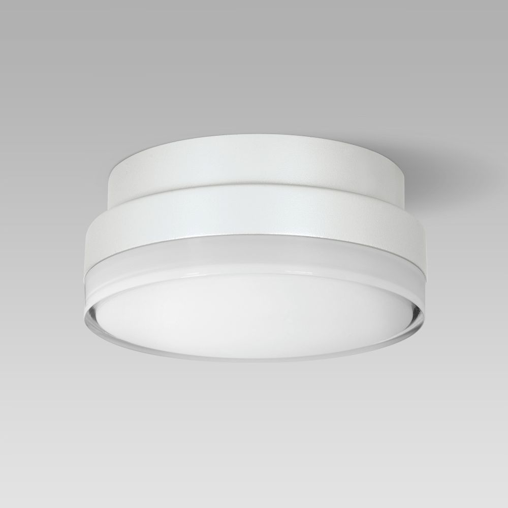 Compact-size and resistant ceiling or wall-mounted luminaire for indoor and outdoor lighting
